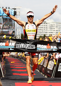 Craig Alexander celebrates winning the Asia-Pacific Ironman Championships.