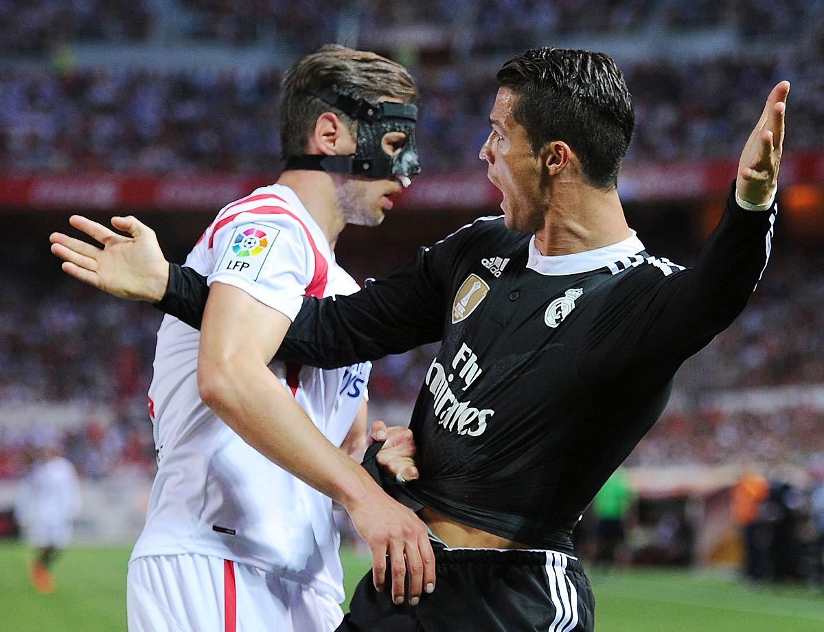 Cristiano Ronaldo of Real Madrid battles with Grzegorz Krychowiak of Sevilla CF.