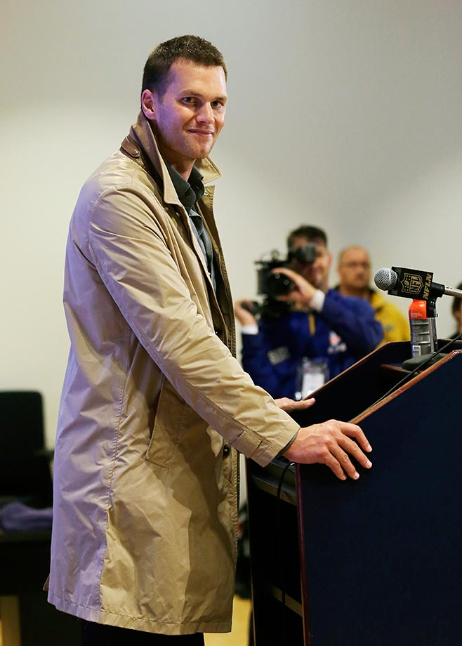 Tom Brady sports the trench coat for the media after the Patriots game against the Pittsburgh Steelers.
