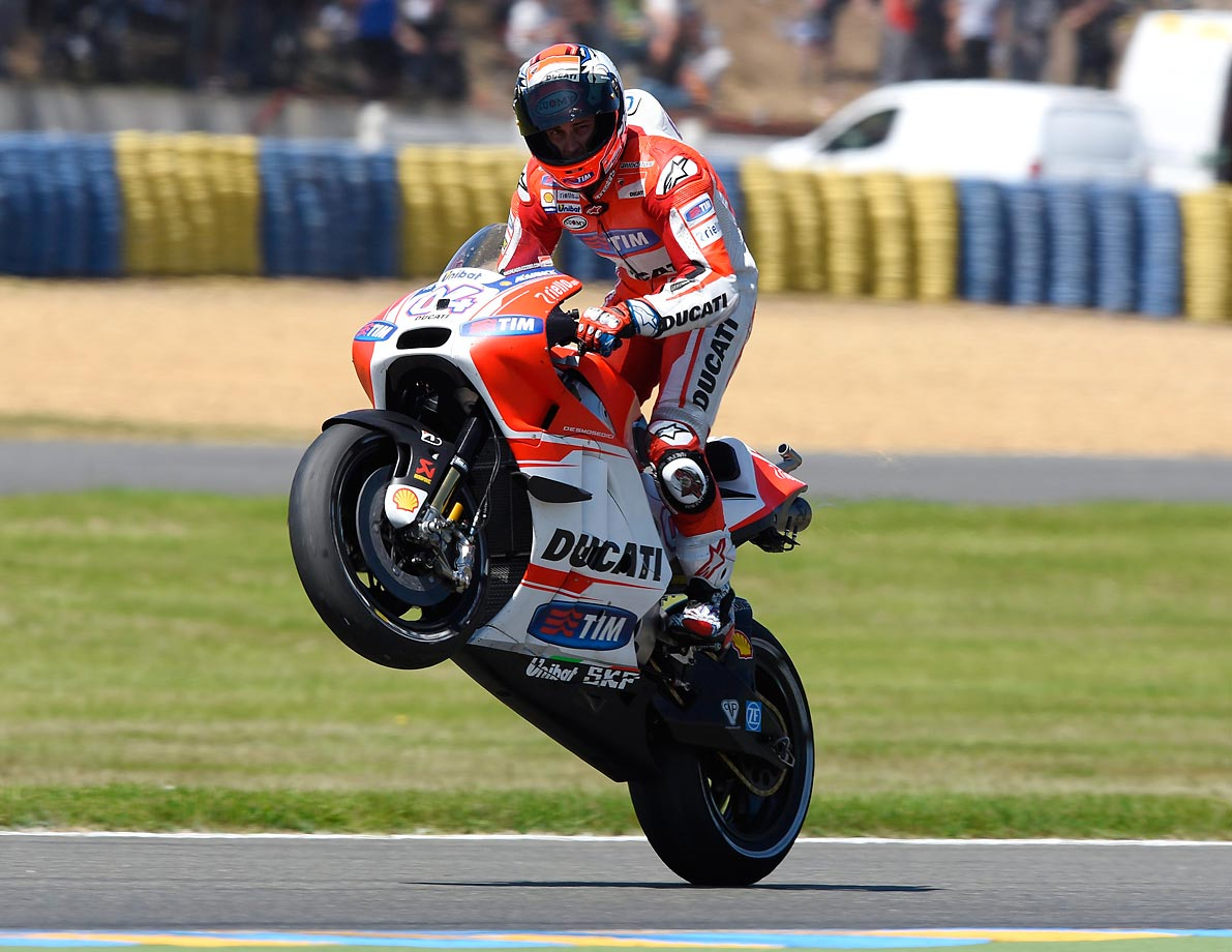 Andrea Dovizioso pulls a wheelie at the Moto Monster Energy Grand Prix in France.