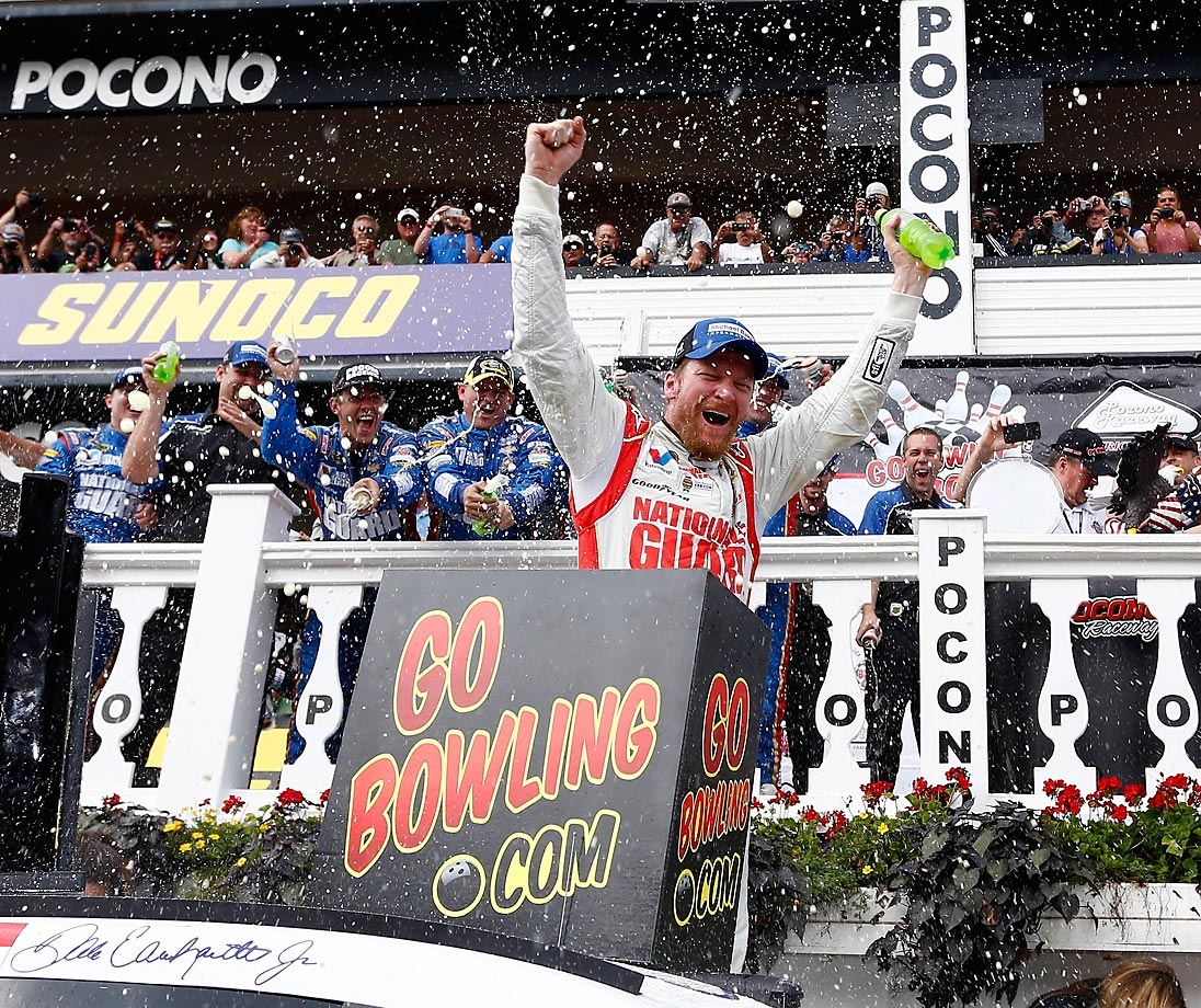 Dale Earnhardt Jr. celebrates in Victory Lane after winning the NASCAR Sprint Cup Series GoBowling.com 400 at Pocono Raceway on August 3, 2014 in Long Pond, Pennsylvania.