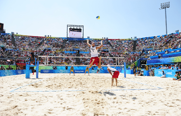 Phil Dalhausser leaps for a serve in the 2008 Summer Olympics against Brazil during the Men's Gold Medal Match at Chaoyang Park BV Ground in Beijing, China.