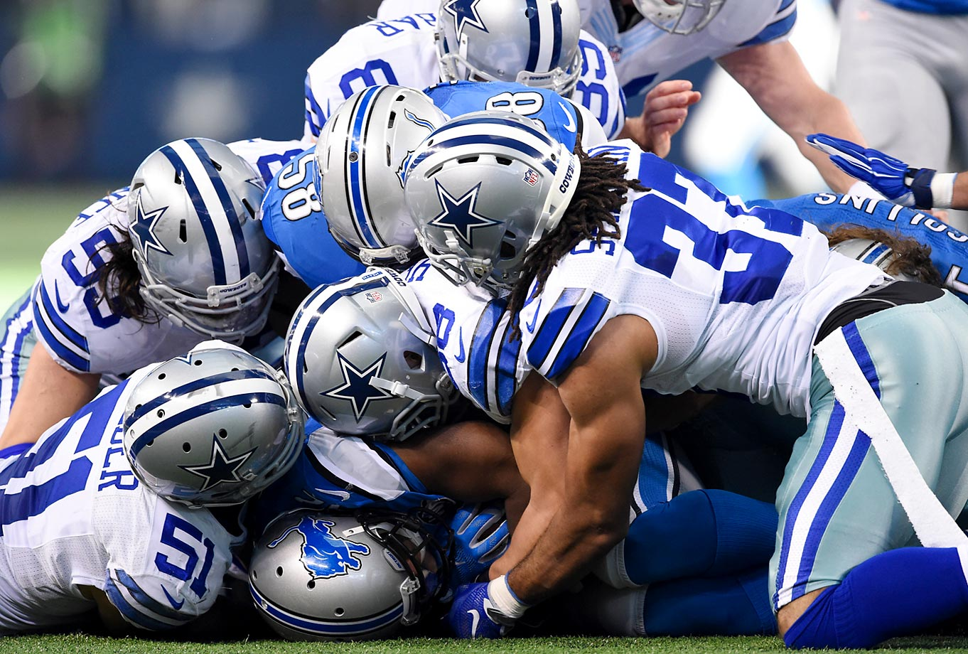 A passel of Cowboys special-teamers -- Kyle Wilber (51), Cameron Lawrence (53), Jeff Heath (38) and C.J. Spillman (37) -- delivered some muff justice to Lions return man Jeremy Ross as he fell on the ball after bobbling a second-quarter punt.