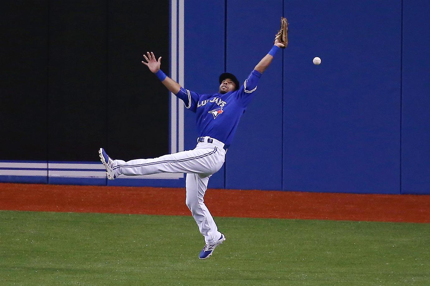 Dalton Pompey of the Toronto Blue Jays misplays a ball against the Atlanta Braves.