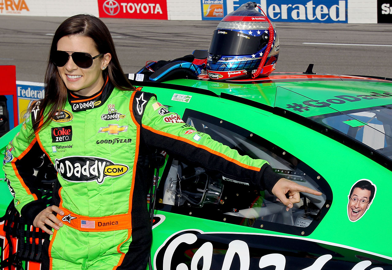 Danica Patrick points to a sticker of Stephen Colbert on her car during qualifying for the NASCAR Sprint Cup Series Toyota Owners 400 at Richmond International Raceway on April 26, 2013 in Richmond, Va.
