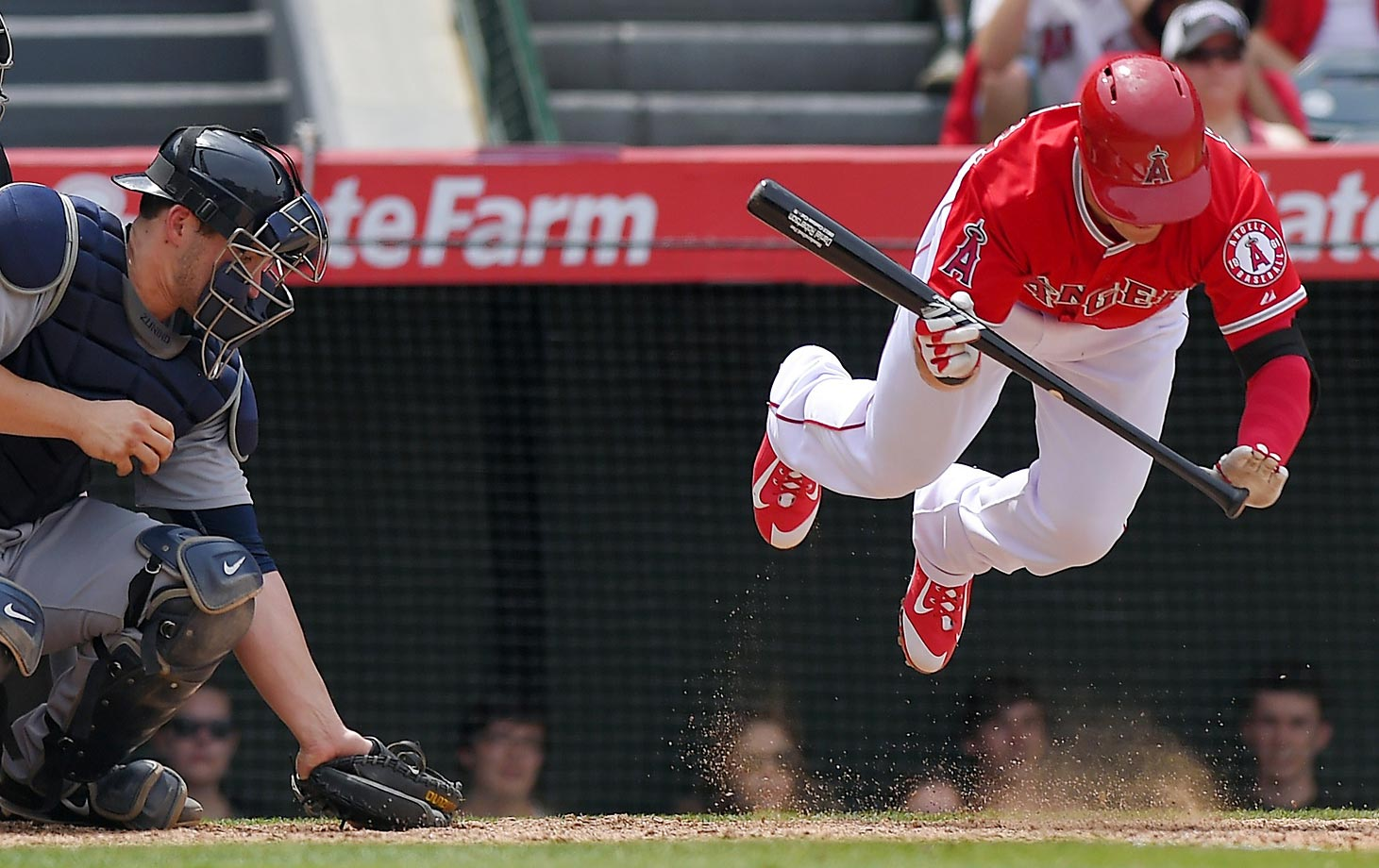 Daniel Robertson of the Los Angeles Angels jumps out of the way of a close pitch against the Seattle Mariners.
