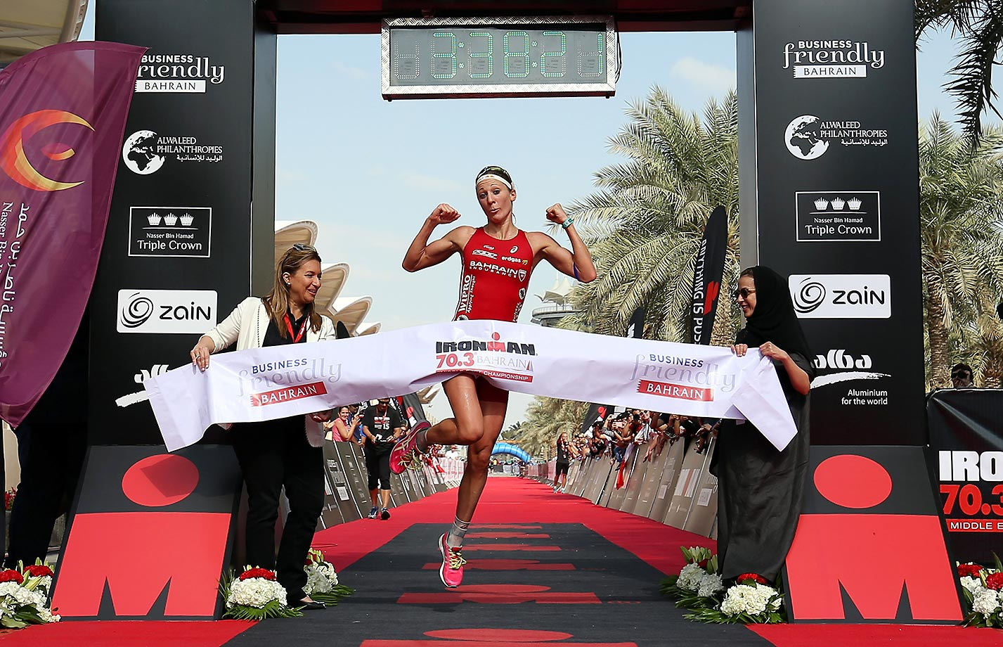 Daniela Ryf of Switzerland celebrates winning the Triple Crown (and $1 million) at the Ironman Bahrain.