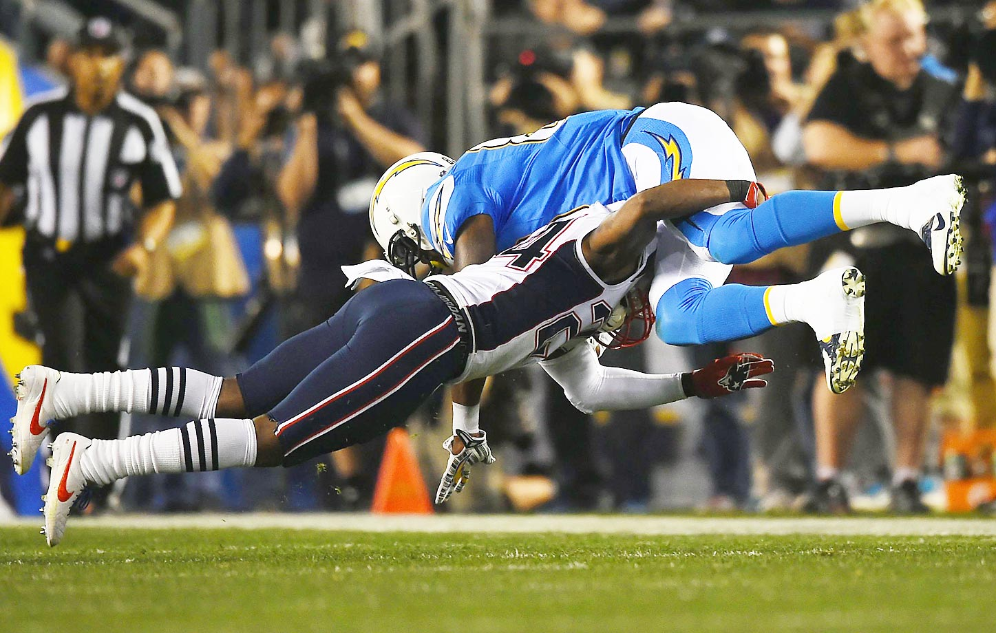 Darrelle Revis of the Patriots tackles Ladarius Green during Sunday's game against the Chargers game.