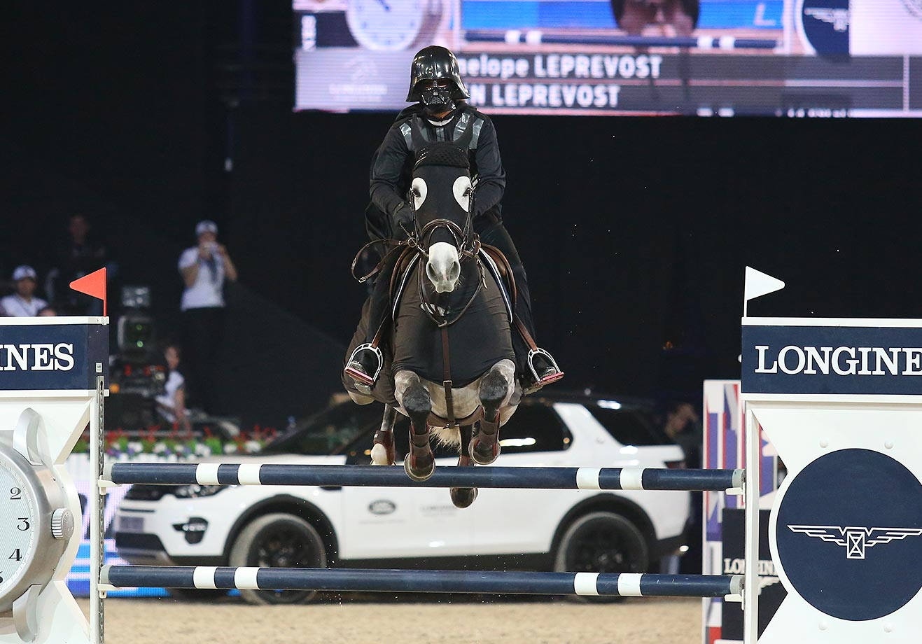 Penelope Leprevost rides as Darth Vader at the 'Style and Competition' show jumping charity event in Paris.