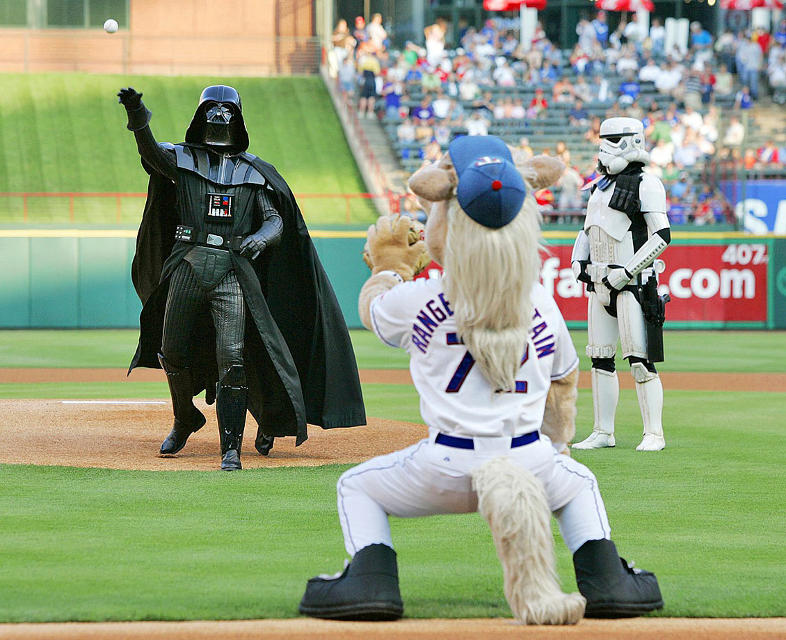 Darth Vader makes the honorary first pitch to Texas Rangers mascot Captain prior to the Rangers game against the Detroit Tigers on June 5, 2007 at The Ballpark in Arlington, Texas.