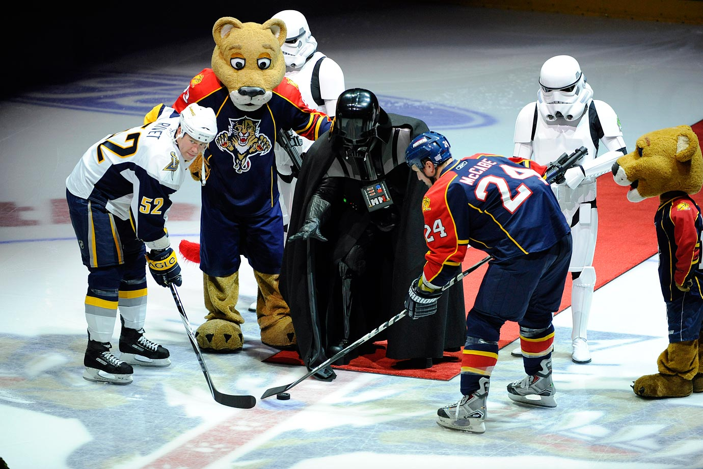 Darth Vader and stormtroopers join Florida Panthers mascot Stanley C. Panther on the ice as Vader drops the puck for the Buffalo Sabres' Craig Rivet and Panthers' Bryan McCabe on Oct. 21, 2009 at BankAtlantic Center in Sunrise, Florida.