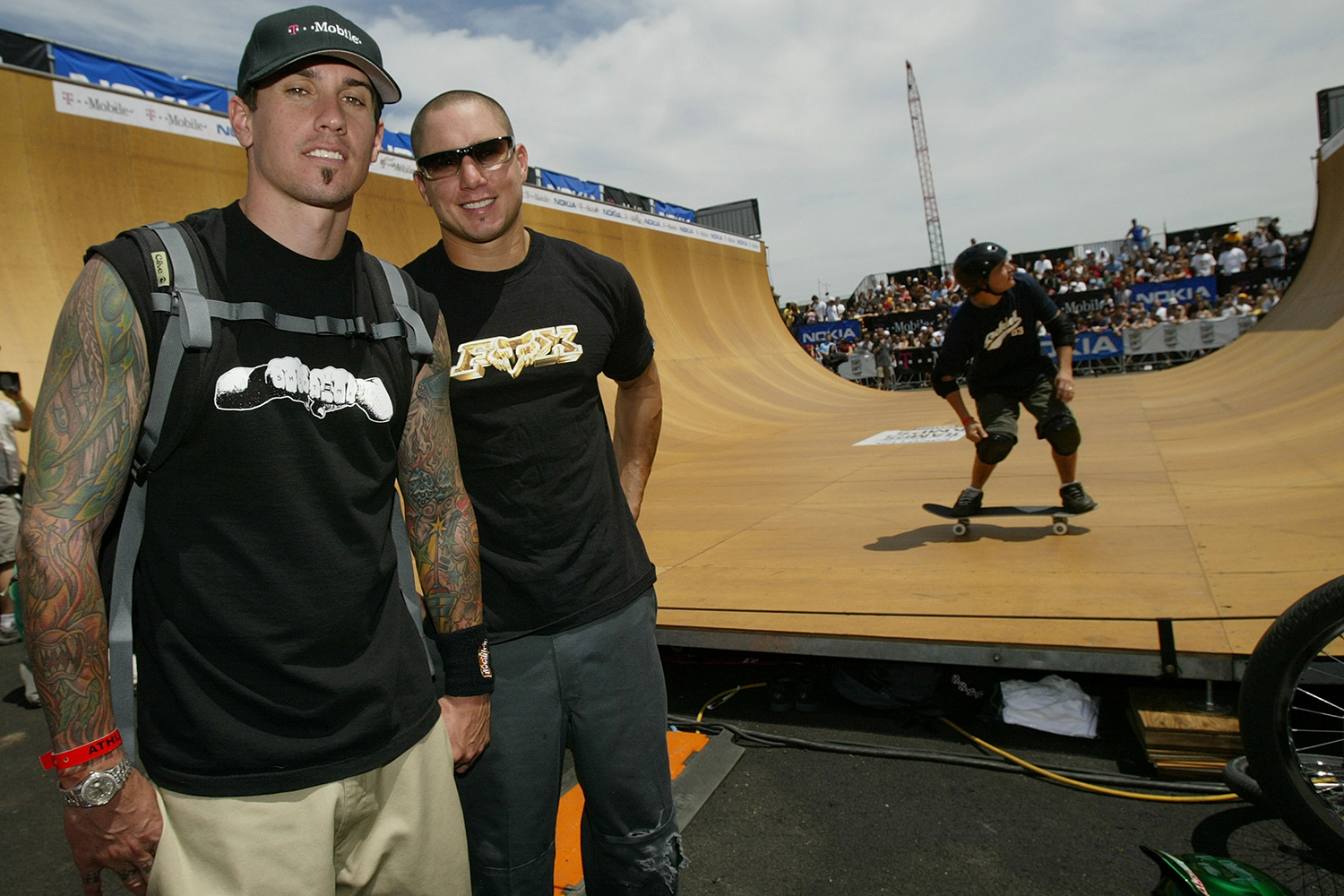 Carey Hart (L) and Dave Mirra (R) attend the Ramps and Amps Invitational on July 19, 2003.