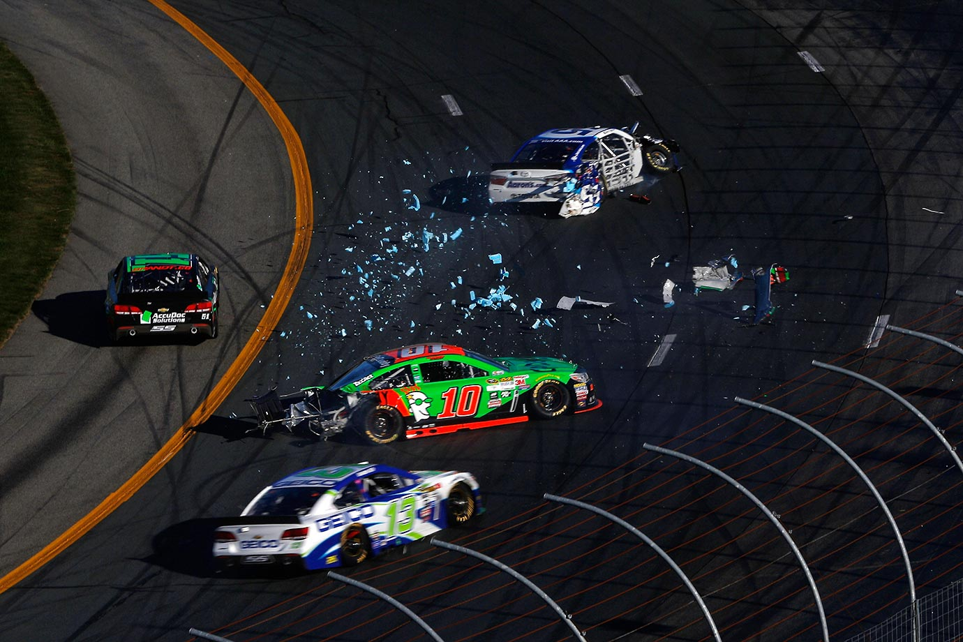 David Ragan (top) knocks the rear end off Danica Patrick's car during the NASCAR Sprint Cup Series SYLVANIA 300 at New Hampshire Motor Speedway.