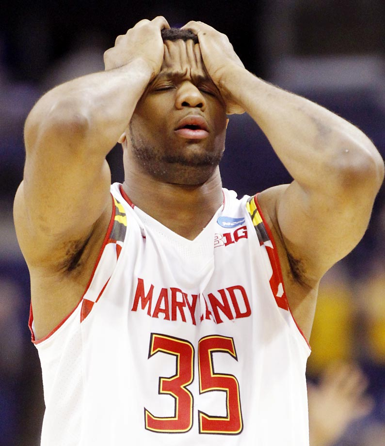 Damonte Dodd of Maryland walks off the court after losing 69-59 to West Virginia.