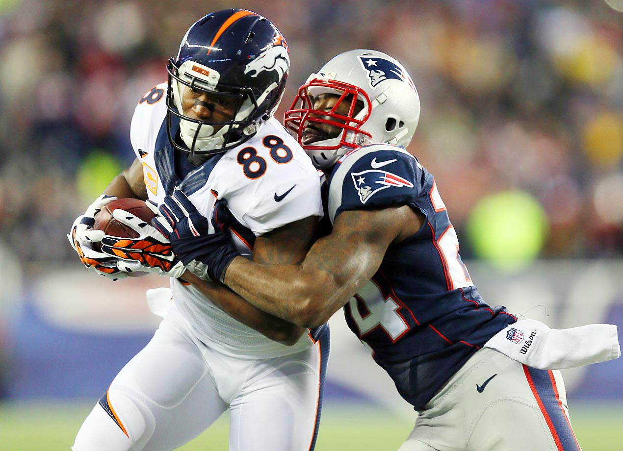 Broncos wide receiver Demaryius Thomas is wrapped up by Patriots cornerback Darrelle Revis. New England won 43-21.