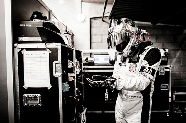 Patrick Dempsey of the USA and Dempsey Racing Proton prepares in the garage ahead of his first stint during the Le Mans 24 Hour Race at Circuit de la Sarthe on June 15, 2014 in Le Mans, France.