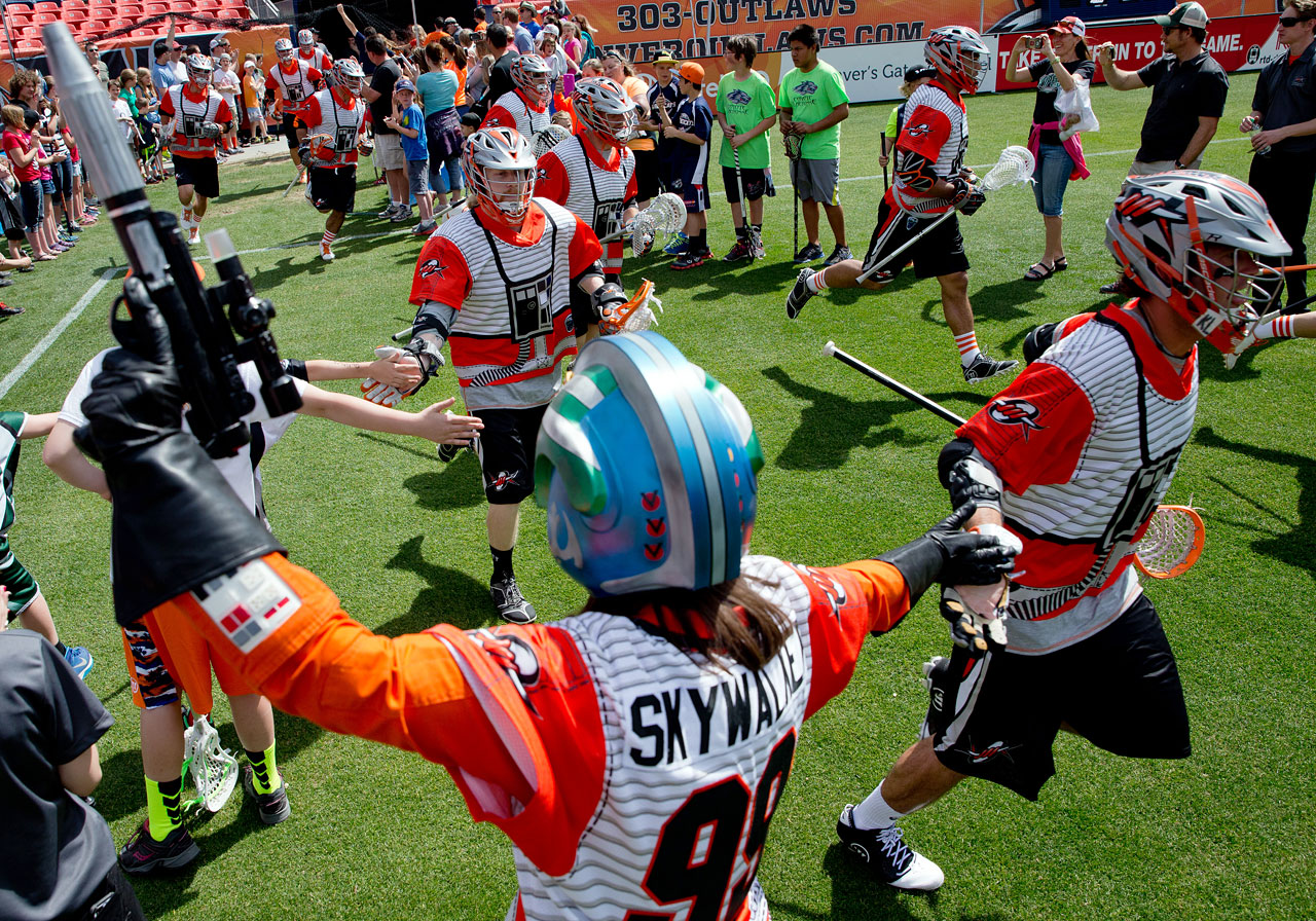 The Denver Outlaws take the field in Rebel Alliance uniforms for their Major League Lacrosse game against the Ohio Machine on May 4, 2014 at Sports Authority Field at Mile High in Denver.