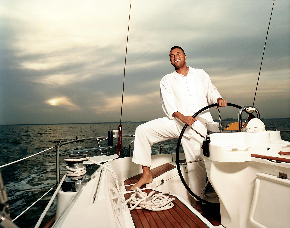The Yankees captain steers a boat near Tampa in 2005. Jeter piloted New York to five World Series titles during his career.