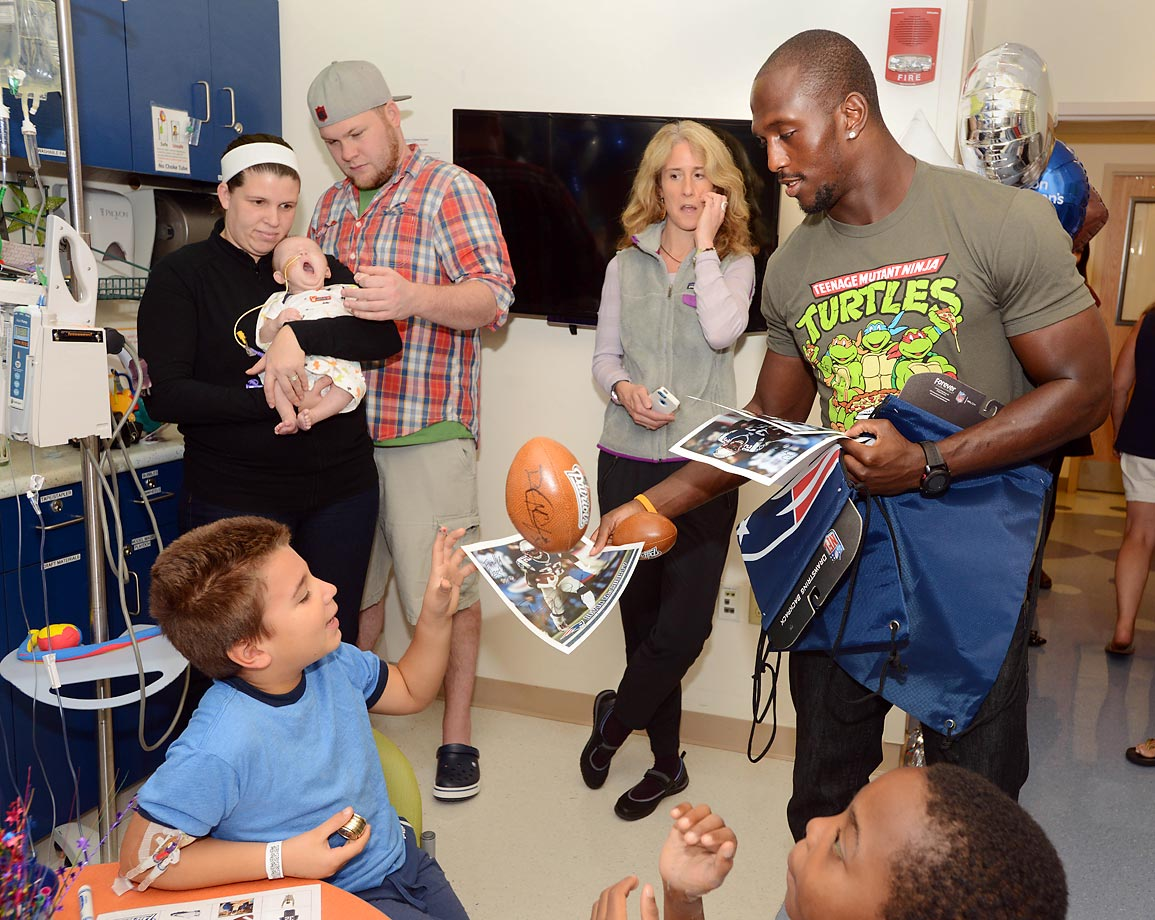 Devin McCourty of the New England Patriots hands out prizes during bingo at Boston Children's Hospital.