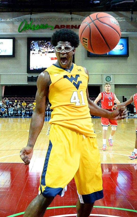 Devin Williams of West Virginia celebrates after dunking against Richmond. West Virginia won 67-59.