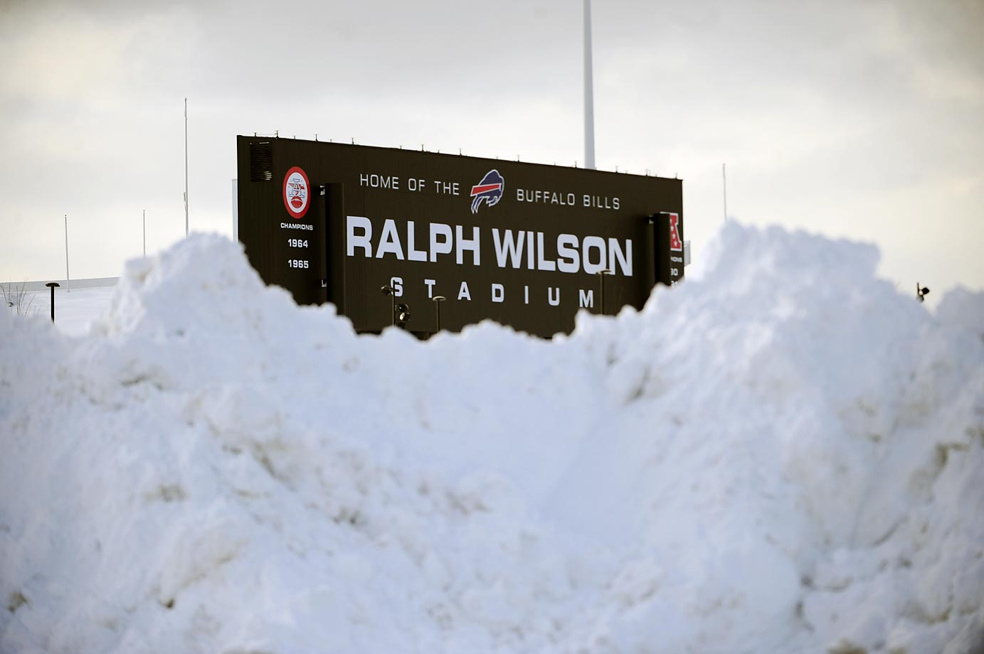 "Huge snowbanks at Ralph Wilson Stadium, part of the snowfall that forced the Buffalo Bills to play their ""home"" football game in Detroit on Monday against the New York Jets."