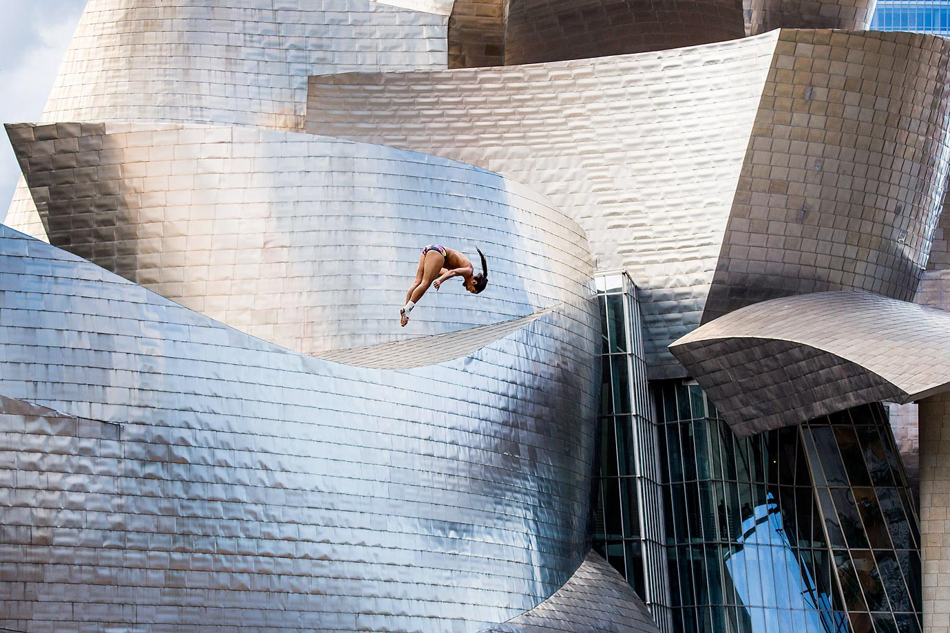 Orlando Duque of Colombia dives from the 27-meter platform on La Salves Bridge next to the Guggenheim Museum in Bilbao, Spain.