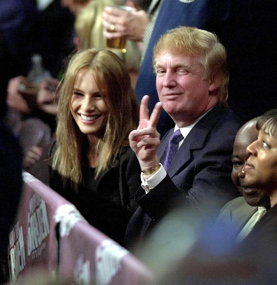 Donald Trump flashes a peace sign before the Lennox Lewis-Michael Grant fight.