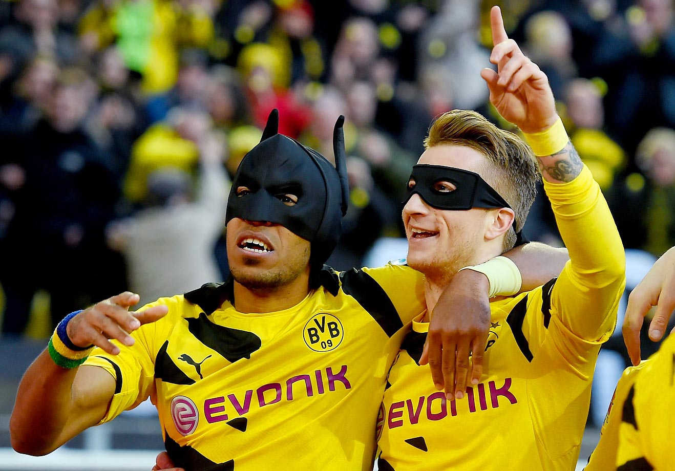 A little Batman and Robin show by Pierre-Emerick Aubameyang and Marco Reus after scoring the team's first goal during their Bundesliga match.