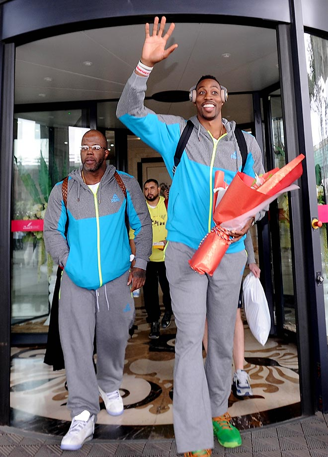 NBA star Dwight Howard takes a trip through Shenyang Taoxian International Airport in China.