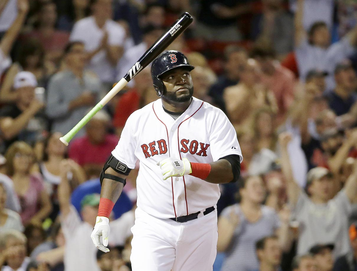 David Ortiz of the Boston Red Sox tosses the bat as he watches his three-run homer against the Detroit Tigers.