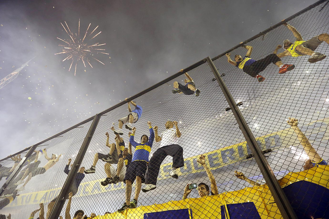 Boca Juniors' fans cheer as fireworks explode before the start of the first leg of the Copa Sudamericana semifinal soccer match against River Plate.