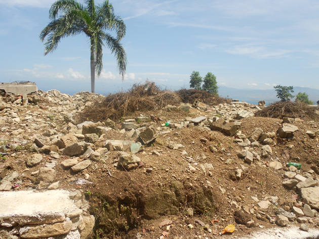 Lourdina was a survivor of Haiti's devastating earthquake in 2010 that created mass graves, as shown here.