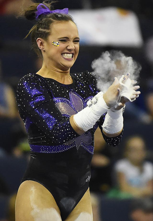 Jessie Jordan of LSU celebrates her 9.850 score on the uneven bars during the SEC gymnastics championship.