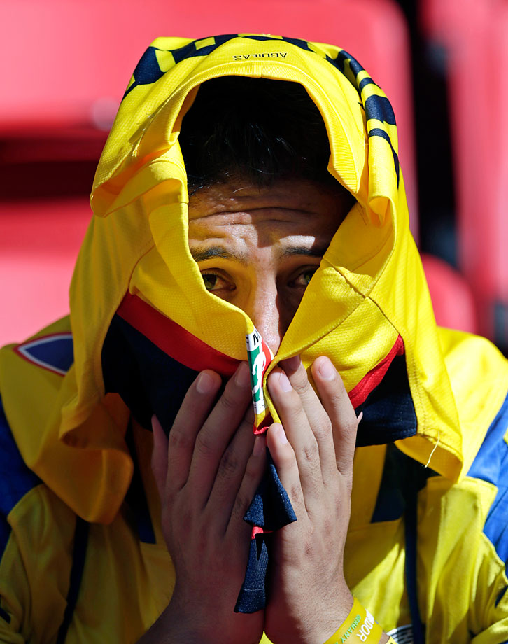 An Ecuadorean fan sits in the stands following Ecuador's 2-1 loss to Switzerland on June 15.