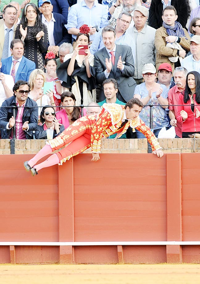 Spanish matador El Fandi jumps a barrier at the Maestranza bullring in Sevilla.
