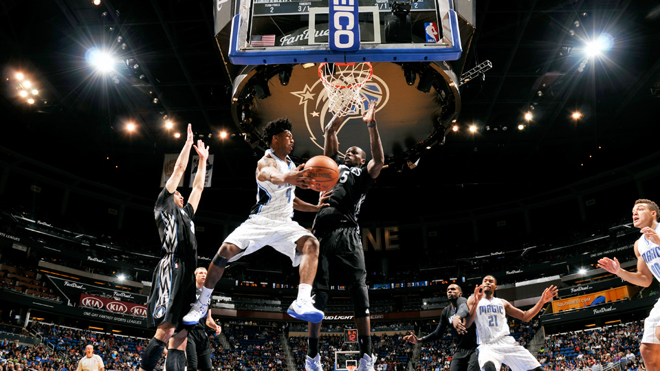 Orlando's Elfrid Payton kicking out a pass from underneath the basket.