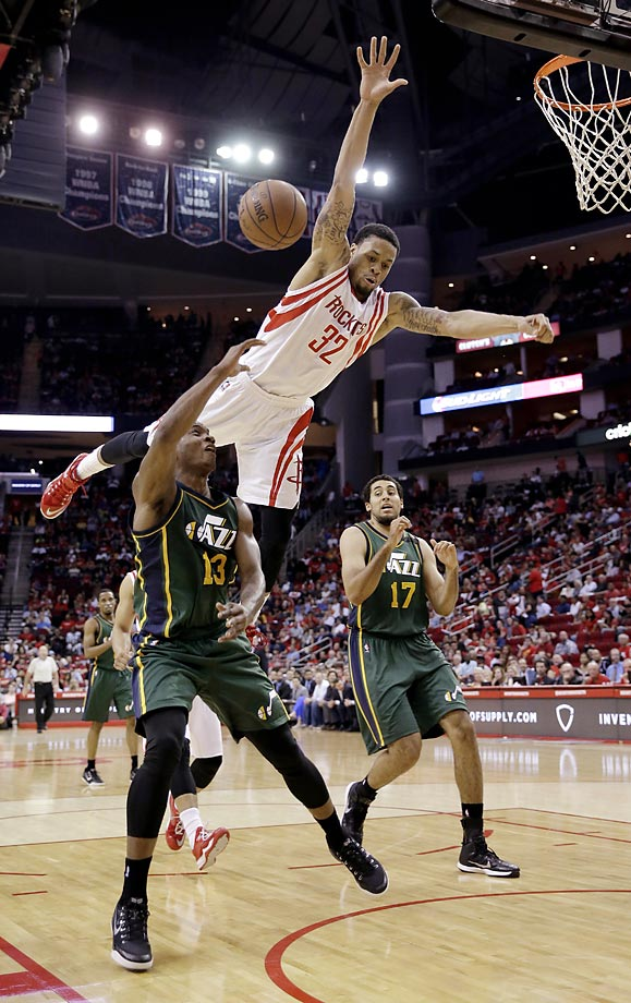 Elijah Millsap of the Utah Jazz is fouled by K.J. McDaniels of the Houston Rockets. The Rockets won 117-91.