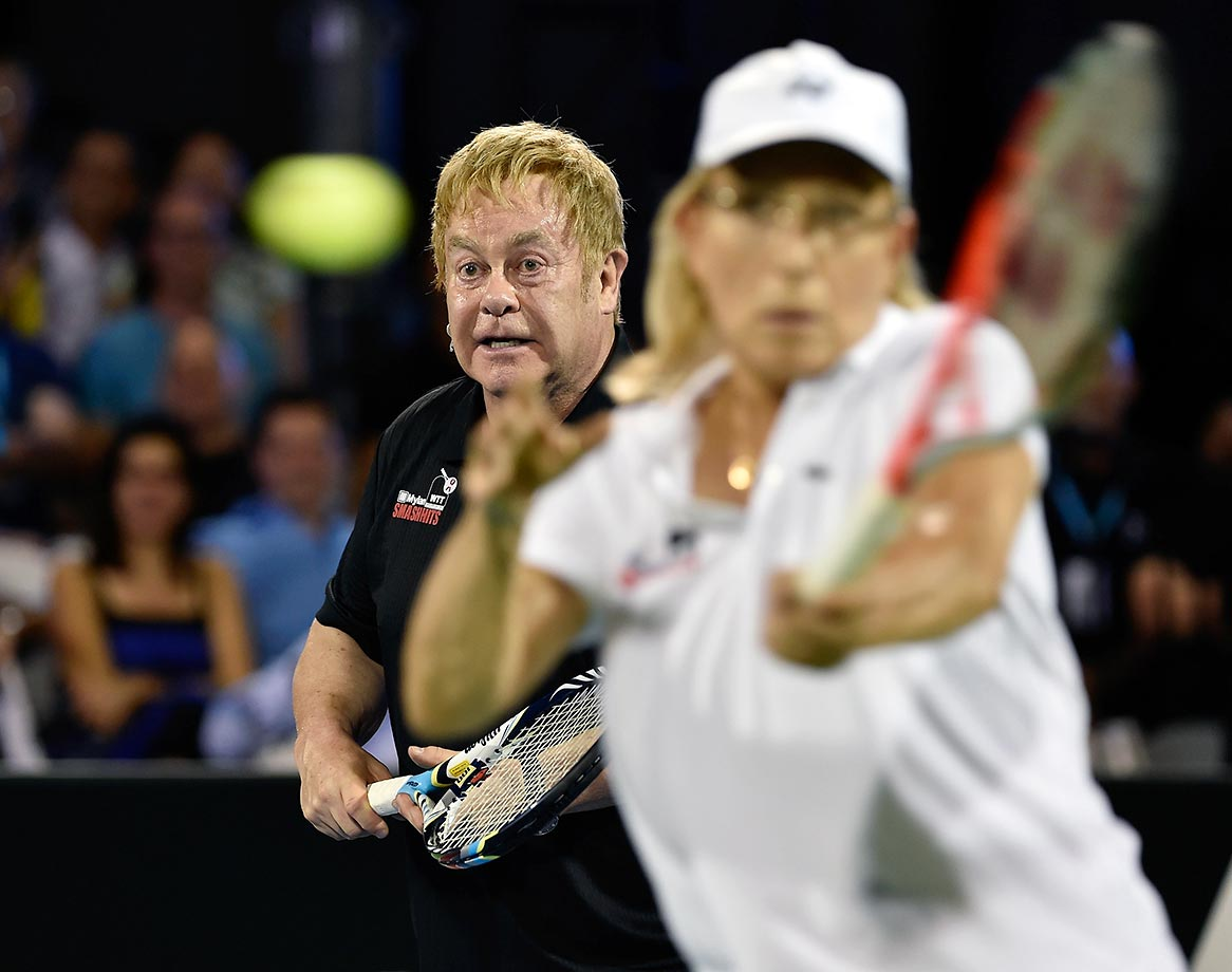 Sir Elton John seems to photo bomb Martina Navratilova, but it was just their doubles match at a charity event at Caesars Palace.