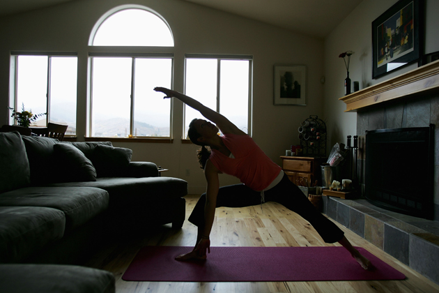Emily Cook, a member of the U.S. Olympic Aerial Ski Team, does yoga in her home in Park City, Utah.