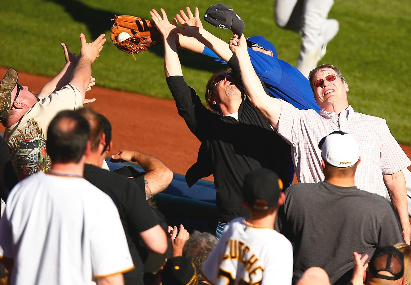 Eric Campbell of the New York Mets attempts to catch a fly ball over fans during a game against the Pittsburgh Pirates.