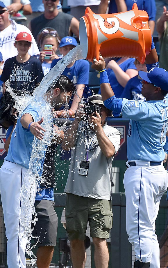 Eric Hosmer of the Kansas City Royals gets doused after he scored the winning run in a game against the Minnesota Twins.