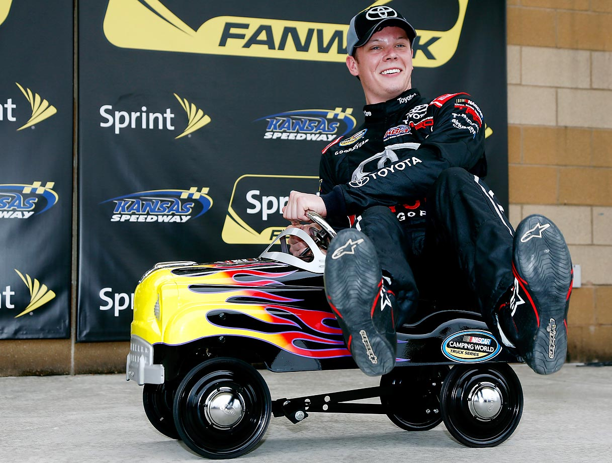 Erik Jones celebrates winning the pole after qualifying for the NASCAR Camping World Truck Series Toyota Tundra 250.