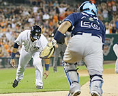 Detroit Tigers shortstop Eugenio Suarez stumbles on his way home during the seventh inning of Sunday night's 7-3 loss to the Rays.