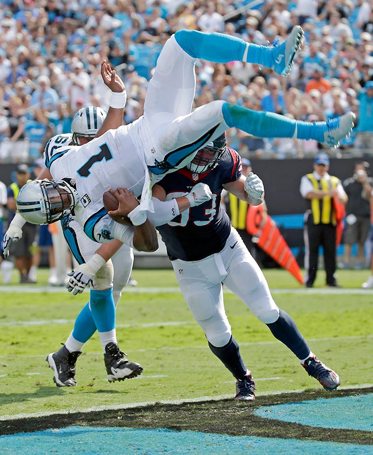Cam Newton dives over Jared Crick for a touchdown.