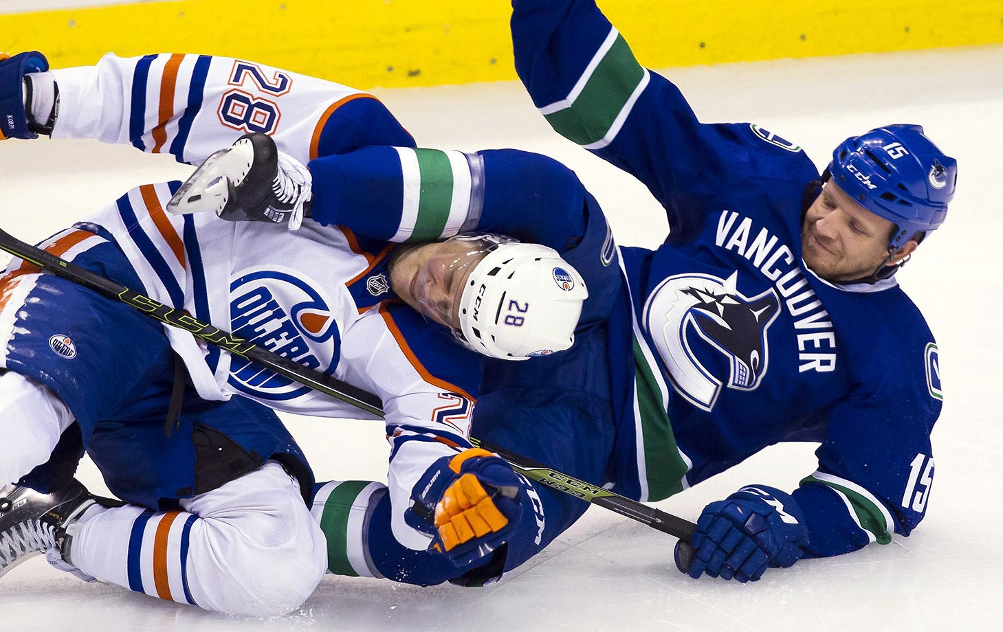 Taylor Hall of the Edmonton Oilers gets tangled up in a game against the Vancouver Canucks.