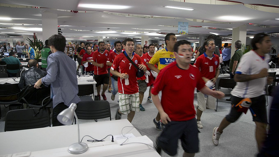 Fans storm the media center at Maracana Stadium, seemingly trying to get through security to watch Chile take on Spain in their World Cup matchup.
