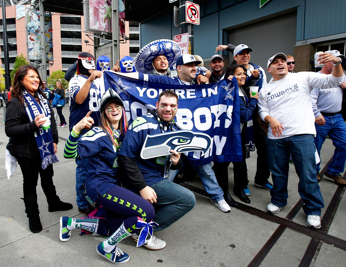 Seattle Seahawks fans photobomb a group of Cowboys fans.