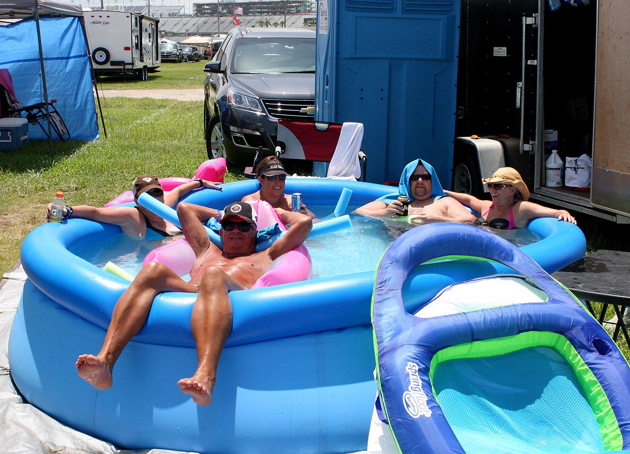NASCAR fans cool off before the Sprint Cup Series Coke Zero 400 race at Daytona.
