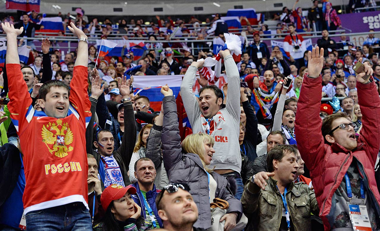 A group of Russian fans attempt to get the wave started during the U.S.-Russia preliminary hockey matchup.
