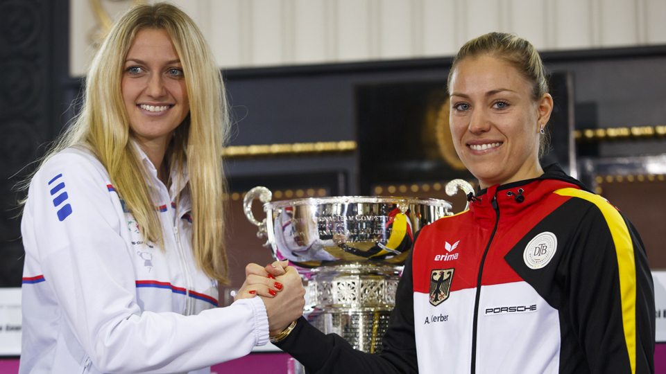 Kvitova shakes hands with Kerber after a draw ceremony prior to the Fed Cup final.